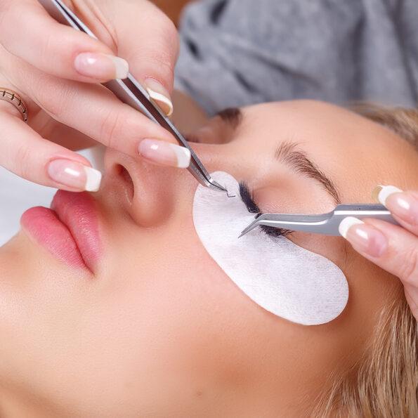 Woman Eye with Long Eyelashes. Eyelash Extension. Lashes. Close up, selected focus